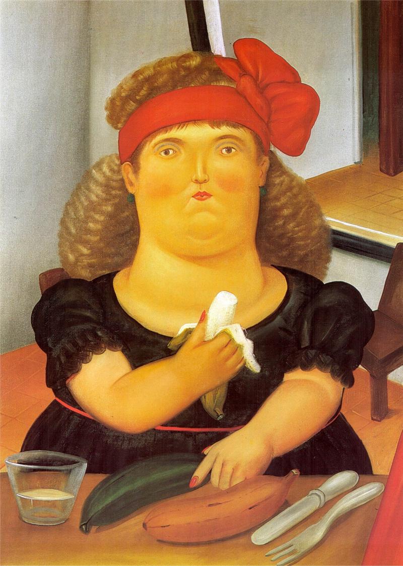 Mujer comiendo una banana